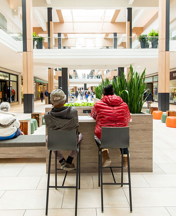 Shoppers sitting in seating area at Rosedale Center
