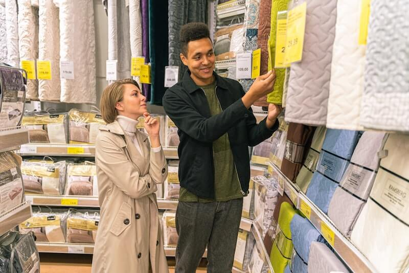 Man and woman shopping in micro-warehouse.