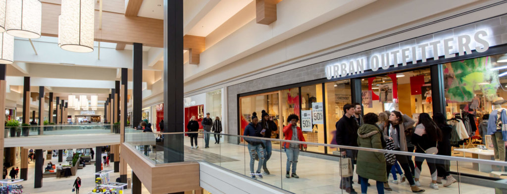 People shopping in the two story Rosedale Center.